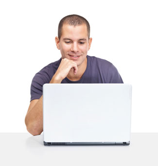 man looking at computer with engaged expression