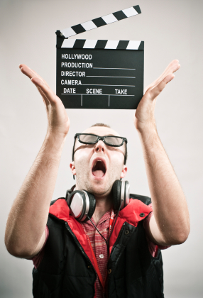 goofy man holding movie clipboard
